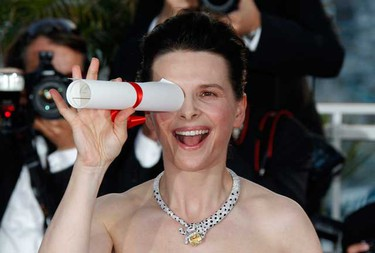 Actress Juliette Binoche poses during a photocall after winning the Best Actress award for her role in Iranian director Abbas Kiarostami's film Copie Conforme (Certified Copy) during the award ceremony of the 63rd Cannes Film Festival May 23, 2010.   (REUTERS)