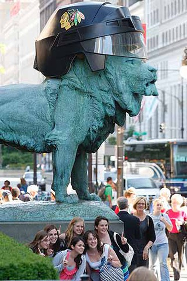 The two historic bronze lions in front of the Art Institute of Chicago added a fashion accessory, Chicago Blackhawks helmets. In tradition for Chicago championship runs, the downtown museum capped the 3-ton lions guarding Michigan Ave entrance with custom made helmets, complete with a visor and Blackhawks logo. (Alex Urosevic/QMI Agency)