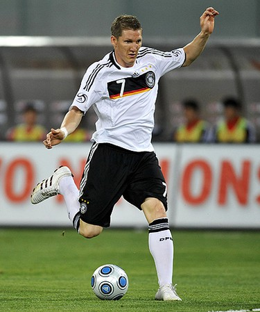 Bastian Schweinsteiger Country: Germany. Position: Winger/Midfielder. Club Team: Bayern Munich. Age: 25. Bio: Schweinsteiger shot into prominence during the third place match at the 2006 World Cup with his dominant play and pair of long-range goals against Portugal. Since then, he has continued to produce at the international level. Just like fellow countryman Miroslav Klose, Germany has never lost a game in which Schweinsteiger has scored. (OLIVER LANG/AFP)