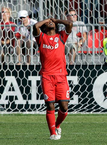 Toronto FC midfielder Julian de Guzman reacts after missing a scoring opportunity against the Kansas City Wizards during the second half of their MLS soccer game in Toronto June 5, 2010. (REUTERS)