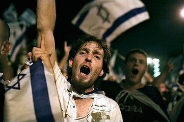 Protesters hold up Israeli national flags and shout slogans during a pro-Israel rally in front of the Turkish embassy in Tel Aviv June 3, 2010. The rally was held in response to events this week after nine Turkish activists were killed in Israel's seizure of a Gaza-bound aid ship.  (REUTERS)
