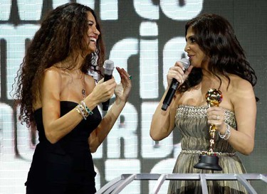 Singer Elissa (R) receives a World Music Award from Afef Jnifen during the World Music Awards in Monte Carlo May 18, 2010. The World Music Awards honours the bestselling recording artists from around the world. (REUTERS)