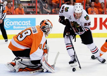 Philadelphia Flyers' Michael Leighton makes a save on Chicago Blackhawks' Ben Eager (R) during the first period in Game 3 of the NHL Stanley Cup final hockey series in Philadelphia, June 2, 2010.   (REUTERS)