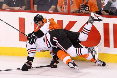 Daniel Carcillo and Ben Eager collide during first period Game 3 of Stanley Cup Final between Chicago Blackhawks and Philadelphia Flyers in Wachovia Center in Philadelphia, June 2, 2010. (Alex Urosevic/QMI Agency)