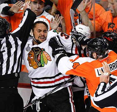 Dustin Byfuglien gets personal with Ian Laperierre during Game 3 of Stanley Cup Final. (Alex Urosevic/QMI Agency)