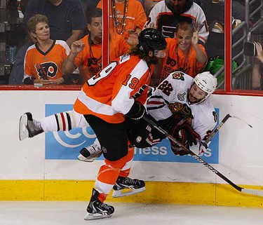 Scott Hartnall hits Troy Brouwer during 3rd period Game 3 of Stanley Cup Final between Chicago Blackhawks and Philadelphia Flyers. (Alex Urosevic/QMI Agency)