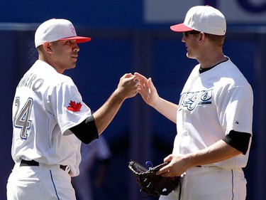 Toronto Blue Jays pitcher Ricky Romero and Lyle Overbay (R) celebrate their win against the Baltimore Orioles during the ninth inning of their MLB American League baseball game in Toronto May 30, 2010.   (REUTERS)