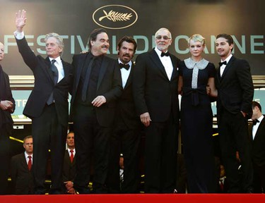 """Director Oliver Stone (2nd L) poses with cast members (L to R) Michael Douglas, Josh Brolin, Frank Langella, Carey Mulligan and Shia Labeouf as they arrive for the screening of the film """"Wall Street - Money Never Sleeps"""" during the 63rd Cannes Film Festival May 14, 2010.   (REUTERS)"""