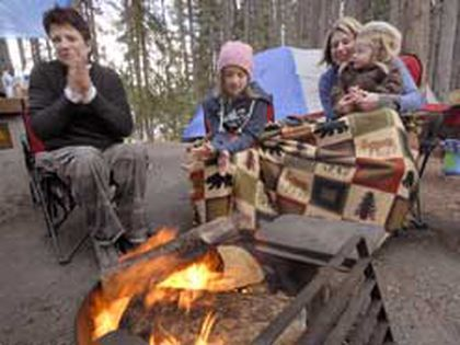 From left are Calgarians Toby Meyer, Madison, Abigail, 2, and Shannon Duer. The campers said that they didn't mind the alcohol ban, but it would have been nice to have one drink at night around the fire. (Photo by PAM DOYLE/QMI Agency)