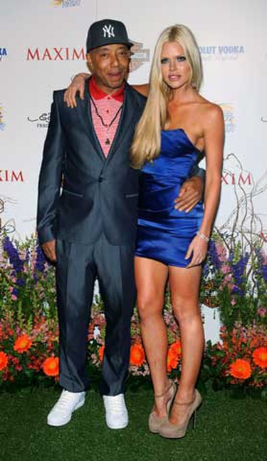Def Jam co-founder Russell Simmons (L) and singer Sophie Monk attend the 11th annual Maxim Hot 100 party in Los Angeles May 19, 2010. (REUTERS)