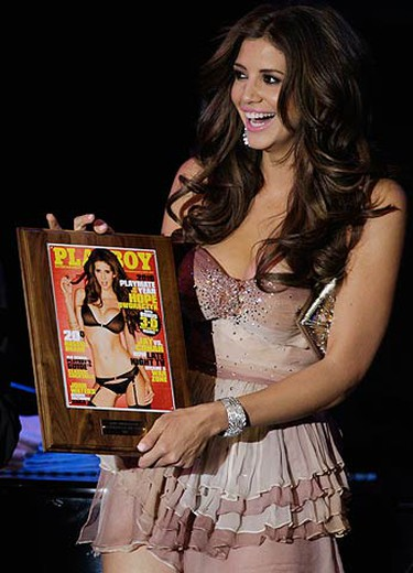 Hope Dworaczyk, 25, Playboy magazine's Playmate of the Year, holds a plaque with the cover of the Playboy June 2010 issue during a celebration at the Palms Casino Resort in Las Vegas, Nevada May 15, 2010. Dworaczyk is featured in the June issue of Playboy magazine and in the magazine's first 3-D centerfold. (REUTERS)