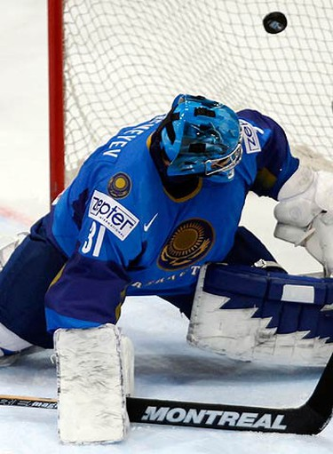 Kazakhstan's goaltender Vitaliy Yeremeyev fails to stop a puck during their Ice Hockey World Championships match against Slovakia in Cologne on May 13, 2010.  (REUTERS)