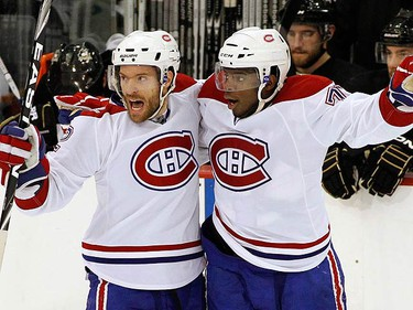 Montreal Canadiens centre Dominic Moore (L) celebrates his first period goal in front of the Pittsburgh Penguins bench with teammate P.K. Subban during Game 7 of their NHL Eastern Conference semifinal hockey series in Pittsburgh, Pennsylvania, May 12, 2010.  (REUTERS)