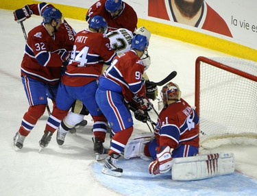 Pittsburgh Penguins' Bill Guerin is snowed under by a sea of Montreal Canadiens' defenders at the edge of the crease during Game 6 Monday night, May 10, at the Bell Centre in Montreal. (ERIC BOLTE QMI Agency)