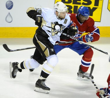 Pittsburgh's Sergei Gonchar and Montreal defenceman P.K. Subbban battle for position during Game 6 Monday night, May 10, at the Bell Centre in Montreal. (ERIC BOLTE QMI Agency)