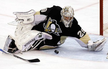 Pittsburgh Penguins' Marc-Andre Fleury makes a save on the Montreal Canadiens during the scond period in Game 5 of their NHL Eastern Conference semi-final hockey series in Pittsburgh, Pennsylvania, May 8, 2010.  (REUTERS)