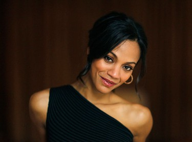 """Actress Zoe Saldana, who stars in the movie """"The Losers"""", poses for a portrait in Beverly Hills, California April 9, 2010. For Saldana, life has changed a lot since she played a tall, blue alien in the top-grossing film of all time, """"Avatar,"""" but one thing remains constant: she is one tough cookie. Picture taken April 9, 2010.    (REUTERS)"""