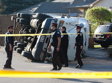 A truck driver is under arrest after he overturned his tractor trailer on an East York residential street early Wednesday morning, Toronto Police said. (JACK BOLAND/Toronto Sun)