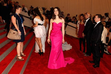 "Actress Rachel Weisz (C) arrives at the Metropolitan Museum of Art Costume Institute Benefit celebrating the opening of ""American Woman: Fashioning a National Identity"" in New York May 3, 2010. (REUTERS)"