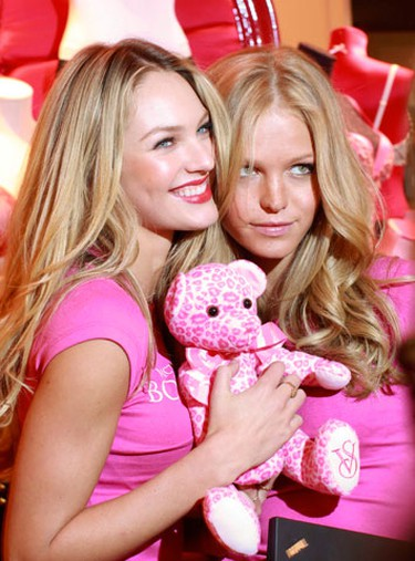 Victoria's Secret Bombshells Candice Swanepoel (L) and Erin Heatherton pose together during an appearance at Victoria's Secret store in New York, February 9, 2010.   (REUTERS)