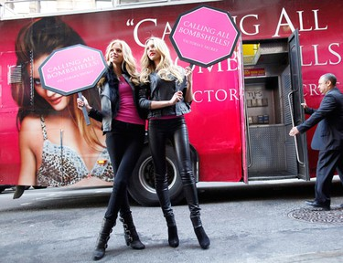Victoria's Secret Bombshells Erin Heatherton (L) and Candice Swanepoel pose together as they arrive for an appearance at Victoria's Secret store in New York, February 9, 2010.   (REUTERS)
