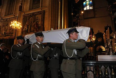 Polish soldiers carry the coffin holding the body of Polish first lady Maria Kaczynska during a funeral procession in Wawel Cathedral in Krakow, on April 18, 2010. Polish and foreign leaders attended a funeral mass on Sunday for President Lech Kaczynski and his wife Maria, but a volcanic ash cloud over Europe prevented some overseas guests from joining them.  (REUTERS)