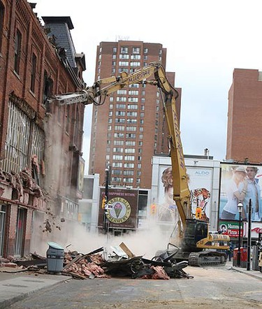 Demolition is underway at a restaurant on Gould St, just east of Yonge St. after a wall collapsed from a building covering a sidewalk below early yesterday. (VERONICA HENRI, Toronto Sun)