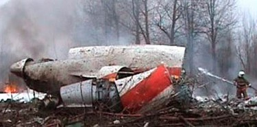 Image from video footage shows a firefighter working to extinguish the flames from the wreckage of a Polish government Tupolev Tu-154 aircraft that crashed near Smolensk airport on April 10, 2010. Poland's President Lech Kaczynski, its central bank head and the country's military chief were among 97 people killed when their plane crashed in thick fog on its approach to a Russian airport.  (REUTERS)