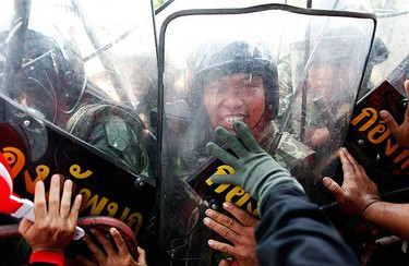 """Anti-government """"red shirt"""" protesters clash with Thai security forces in central Bangkok on April 10, 2010. (REUTERS)"""