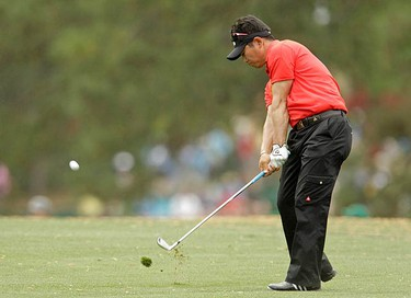 Yong-Eun Yang of South Korea hits his approach shot to the 17th green during first round play in the 2010 Masters golf tournament at the Augusta National Golf Club in Augusta, Georgia, on April 8, 2010.  (REUTERS)