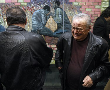 Family members of the fallen workers shed a tear after the quilt in unveiled at the Yonge/York Mills Subway station. The workers who perished were Giovanni Fusillo, Pasquale Allegrezza, Giovanni Battista Carriglio, and brothers Alessandro and Guido Mantella. The deaths caused an uproar and prompted the government to write safety regulations.(Dave Abel/Toronto Sun)