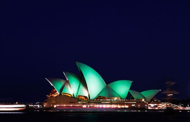 The Sydney Opera House is lit with green lights during St Patrick's Day celebrations in central Sydney March 17, 2010. (REUTERS)