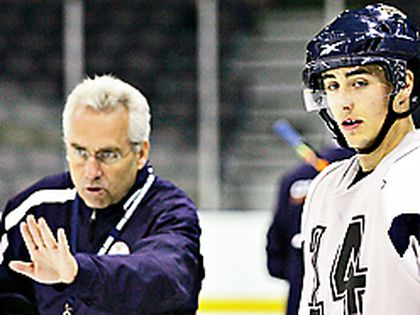 Oilers prospect Jordan Eberle, right, listens as associate coach Tom Renney gives instruction in a preseason workout. There's a reason Eberle isn't with this current losing group of Oilers. (AMBER BRACKEN/Edmonton Sun)