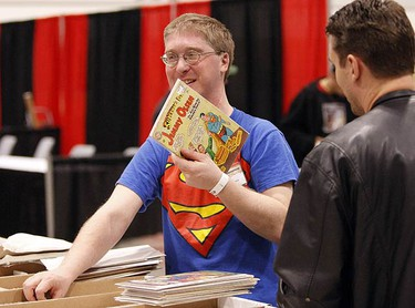 Jason Major digs out a find at Comic Con on March 26, 2010. The event runs this weekend at the Direct Energy Centre at the CNE. (MIKE PEAKE, Toronto Sun)