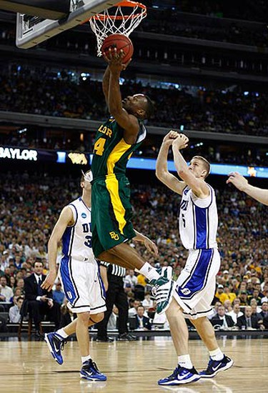 Baylor guard LaceDarius Dunn (C) goes up for a layup against Duke forward Mason Plumlee (R) and guard Jon Scheyer (L) in the first half of their NCAA South Regional college basketball game in Houston, Texas, on March 28, 2010.  (REUTERS)