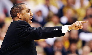 Washington's coach Lorenzo Romar directs his team as they play West Virginia during the first half of their NCAA East Regional college basketball game in Syracuse, New York on March 25, 2010.  (REUTERS)