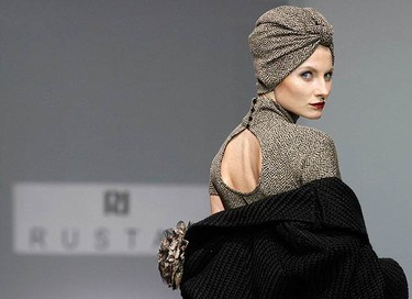 Models present creations by Russian designer Rustam during Fashion Week in Moscow on March 21, 2010.  (REUTERS)