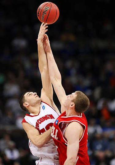 Wisconsin Badgers's Keaton Nankivil (L) goes up against Cornell Big Red's Jeff Foote (R) at the start of the second round of the NCAA Division I men's basketball championship tournament game in Jacksonville, Florida on March 21, 2010. (REUTERS)