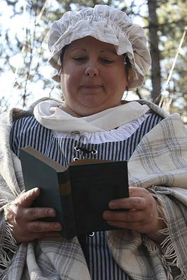 A poplualr 17th century author read to visitors on March 17, 2010. Volunteers played their part at the Pickering Museum Village. The settler trail was in full swing this afternoon for march break visitors and takes a little over an hour to travel back in time. The hike through the woods shows the young and old how settlers endured their first winter in Canada. (VERONICA HENRI, Toronto Sun)