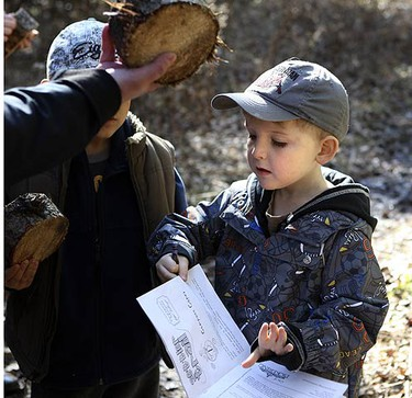 Liam Hunt, 4, gets the facts and puts them in his book on March 17, 2010. Volunteers played their part at the Pickering Museum Village. The settler trail was in full swing this afternoon for march break visitors and takes a little over an hour to travel back in time. The hike through the woods shows the young and old how settlers endured their first winter in Canada. (VERONICA HENRI, Toronto Sun)