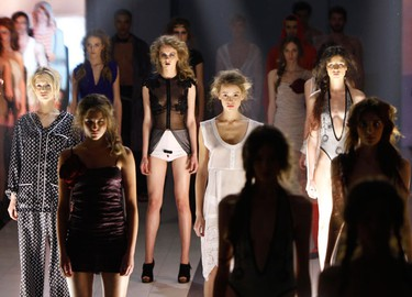 Models display creations during a special show organized for the Elena Franchuk ANTIAIDS Foundation during Ukrainian Fashion Week in Kiev March 16, 2010.  (REUTERS)