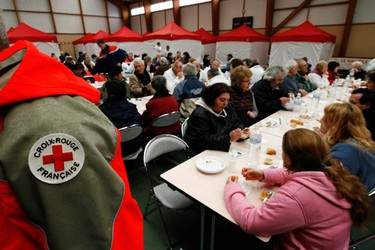 Flood victims gather in a communal centre in La-Faute-sur-Mer in western France March 1, 2010 following a major storm. France's government has declared a natural disaster, enabling victims to claim compensation and free up insurance claims. France will also seek European Union aid for the region. (STEPHANE MAHE/Reuters)