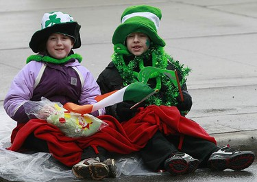 """Toronto went green today as the 23rd annual St. Patrick's Day parade took over the downtown core. Thousands of people, Irish or just Irish for the day, lined the sidewalks to watch the parade. Floats, dancers, marching bands and people in """"charecter' were the order of the day. (MARK O'NEILL, Toronto Sun)"""