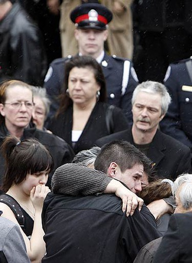 Friends and family gather outside at the funeral for Ken Einboden, 44, and his daughter Britney, 12, at the United Church on March 13, 2010. It's believed a kitchen fire led to the blaze that killed Einboden and his daughter. (DAVE ABEL, Toronto Sun)