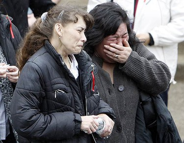 Jacqueline McGregor Einboden is comforted by friends and family at the funeral for Ken Einboden, 44, and his daughter Britney, 12, at the United Church on March 13, 2010. It's believed a kitchen fire led to the blaze that killed Einboden and his daughter. (DAVE ABEL, Toronto Sun)
