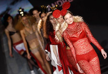Models display creations by Spanish designer Andres Sarda during the Cibeles Madrid Fashion Week Fall/Winter 2010 show in Madrid February 22, 2010.  (REUTERS)