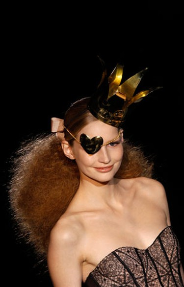 A model displays a creation by Spanish designer Andres Sarda during the Cibeles Madrid Fashion Week Fall/Winter 2010 show in Madrid February 22, 2010.  (REUTERS)
