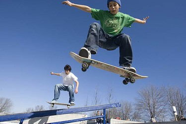 Isaac Nicolalde, 13, and his buddy Junior Casinha, 11, were high flying in great weather in the Beaches on March 7, 2010. The GTA experienced above average temperatures over the weekend and Torontonians took full advantage.  (STAN BEHAL, Toronto Sun)