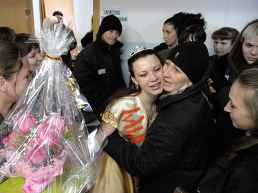 """Inmate Tatyana Ignatenko is congratulated by her supporters after winning a """"Lady Spring 2010"""" beauty contest at a prison camp for women in Selo Gornoye, some 160 km (99 miles) north of the far eastern city of Vladivostok, March 4, 2010.  (REUTERS)"""