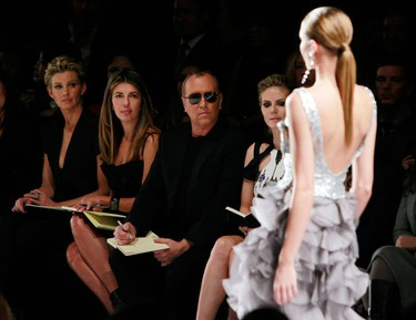 """Judges: (L-R) Singer Faith Hill, Nina Garcia, Michael Kors and Heidi Klum watch a model presents a creation during the Project Runway Fall 2010 fashion show at New York Fashion Week, February 12, 2010. Ten contestants of """"Project Runway"""" showed collections anonymously on Friday at New York Fashion Week, part of the reality show's efforts to keep the three finalists secret until the television season ends. (REUTERS)"""